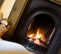 Cosy open fire in the guest lounge at Plumtree House near Kendal in the lake District